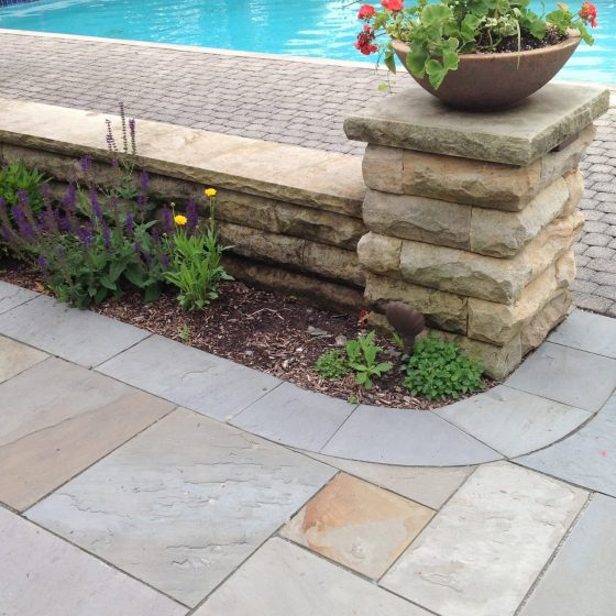 Slate Pool Deck Leading to Concrete Pavers Pool Surround